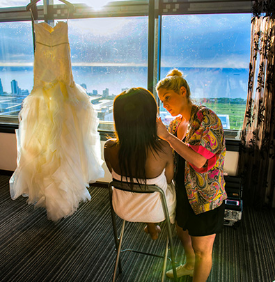 Wedding photographers Durban capturing a bride getting her makeup done
