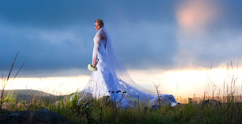 Wedding photographer Durban capturing bride in Midlands with sun setting behind her