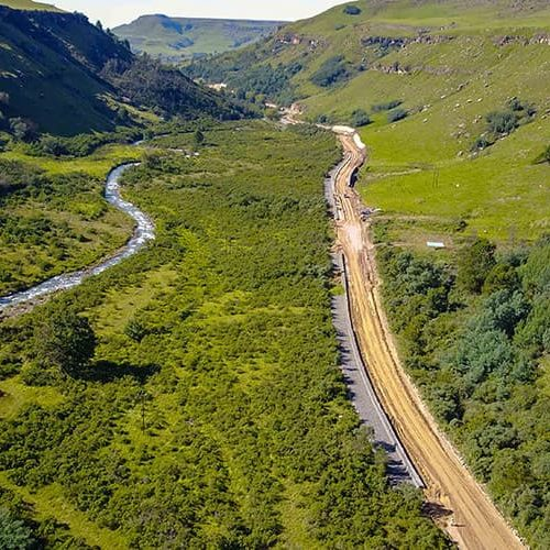 aerial view of beginning of Sani Pass road upgrade construction photography videography
