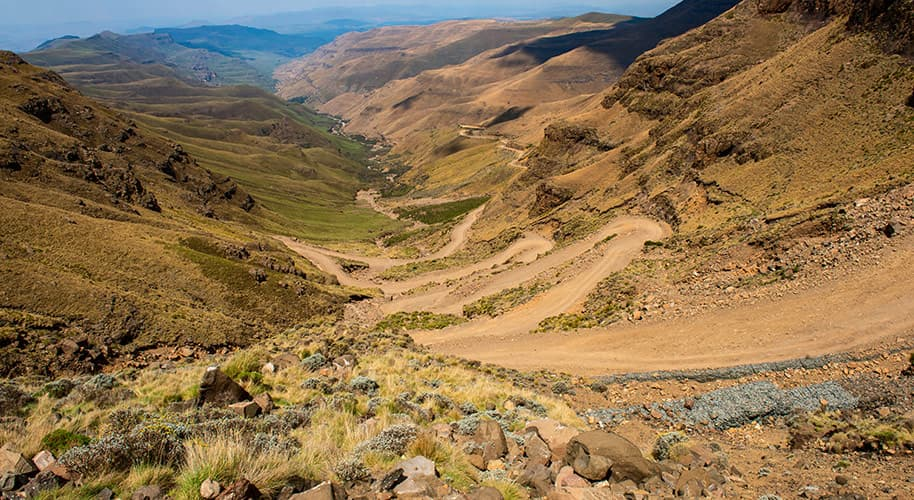 view of Sani Pass showing the zigzagging road up the pass construction photography videography