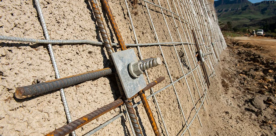 close up of wall supports to stop landslides construction photography videography