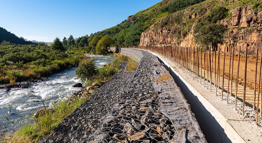 the-raging-river-and-the-large-retaining-wall-constructed-to-stop-any-floods-construction-photography-videography