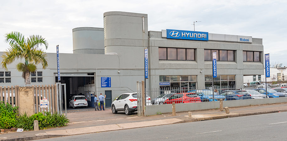 Hyundai South car dealership front entrance with doors open