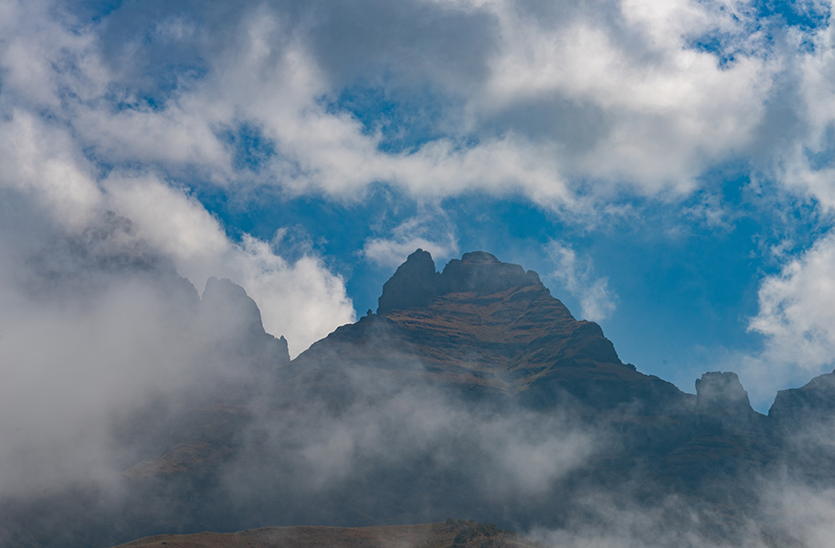 mountains covered in low lying clouds